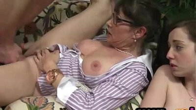 Mature daddy sucks young girl in threesome