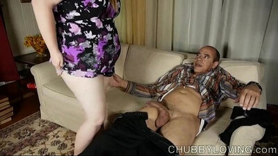 BBW Gives a Footjob Through Menhole Door