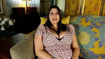 Busty brunette Jolene rubs her fat pussy