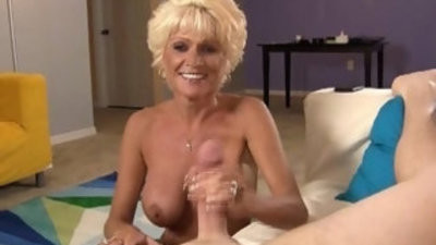 Sluty mature lady wanks off a youthful guy