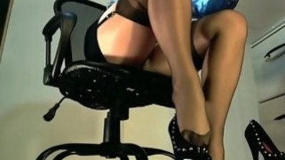 Underdesk tease showcaseing stockings over nylons