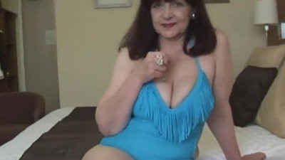 Attractive boy hogam titranssexual horny mature lady in taut swimsuit playing on fitness ball