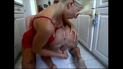 Busty mistress gives blowjob to slave