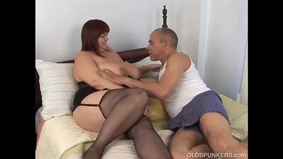 Chubby blonde mature creams her big tits
