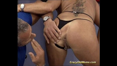 Two slutty mature bitch Angie fucks with a guy in the gym