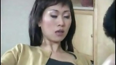 Asian chick with faux cock salesman