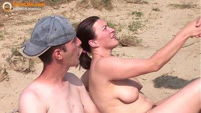 Amateur having a hot threeway sex on the beach