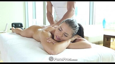 Brunette beauty gets massaged by her lover on sofa