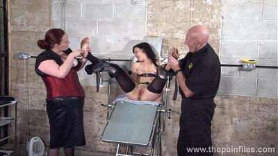 Curvy bdsm fetish slave Liza and Glen hammer the dungeon walls