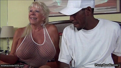 African grandma tasting two massive cocks at one time