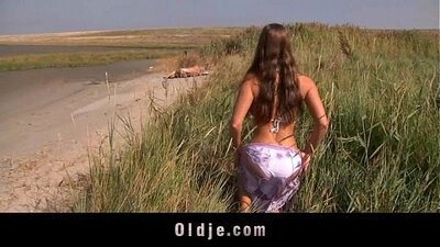 Busty beautie fucked then fucks on dildo boots play at the beach